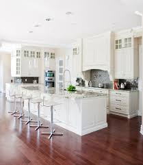 transitional white kitchens with black tile backsplash and faucet