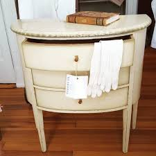 swedish antique side table or nightstand painted in cream color