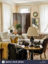 in livingroom white muslin window drapes in living room with 4 segment screen by