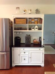 woman transforms old hutch cabinet for her kitchen