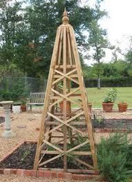wooden hexagon obelisk garden inspiration arbors