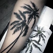 black ink palm tree on leg