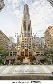 Rockefeller Center Summer Garden - american flags at rockefeller center in new york stock photo