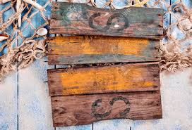 single old wooden blank sign with rusty nails and faded paint
