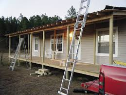 single wide mobile home with wrap around porch