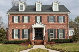 red brick colonial house exterior thinking a black door is in my
