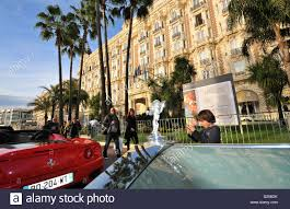 cars and people in front of carlton hotel cannes cote d u0027azur