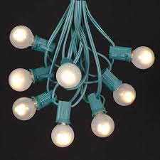 frosted white g30 globe outdoor string light set on green