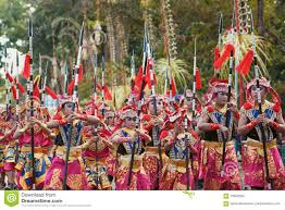 children inbalinese costumes with ethnic decorations on parade at