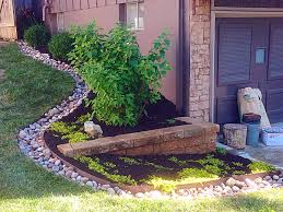 Bush Rock Garden Edging by Landscape Bed With Plantings And Small Retaining Wall Large Rock Cobble Edging Winklers Lawn Care Landscape Jpg