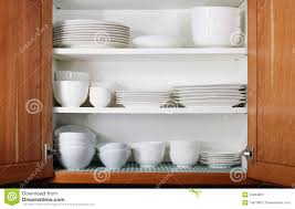 Kitchen Dish Cabinet New White Dishes And Bowls In Kitchen Cabinet Stock Image Image