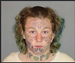 tattooed poses for most terrifying mugshot ever popdust