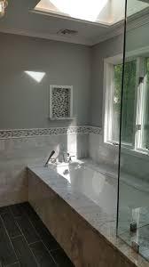 new york slate bathroom tile transitional with white window trim