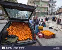 mercedes market selling oranges from the back of a mercedes at a market in