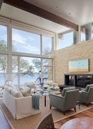 floor to ceiling windows sofas fireplace lake views weekend