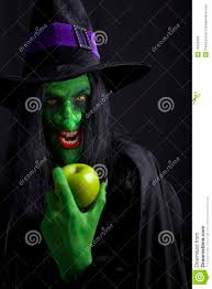 scary witch holding an apple stock photos image 16505963