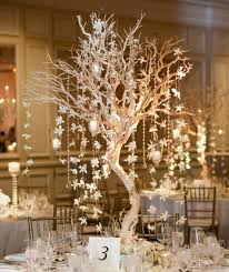 table centerpieces ideas wood led candles and purple flowers winter wedding table decor