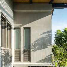 the outside wall of house with natural cement finishing home