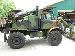 mercedes truck lifted military unimog loader and backhoe antizombie vehicle