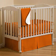 Solid Wood Mini Crib by Solid Orange Portable Crib Bedding Carousel Designs