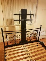 cast iron double bed frame with built in tv stand in royton