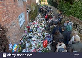 goring george michael flowers candles and words of sympathy were left outside george