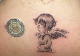 baby angel cupid tattoo photo 2 photo pictures and sketches