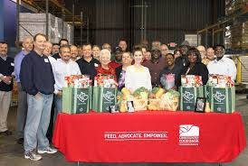 epr retail news harris teeter and food bank volunteers gathered at
