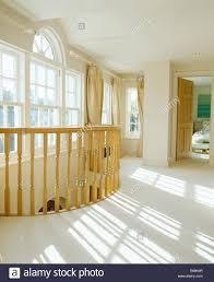 Wood Banisters White Carpet On Large Country Landing With Pale Wood Banisters