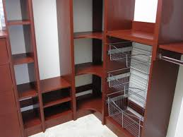 elegant red cherry wooden corner walk in closet organizers for