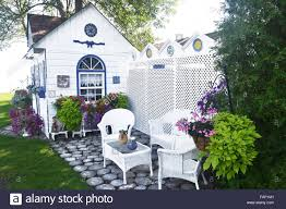 a beautiful small garden shed with nice chairs and a lot of