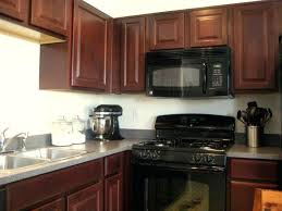 what color cabinets go with black appliances what color to paint kitchen cabinets with black appliances faced