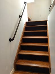 how to make a banister for stairs painted pipe handrail on wall at beginning of stairs basement