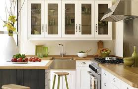 kitchen kitchen storage cabinet in white made of wood with glass