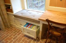 white wooden windows seat with white drawer and shelves having