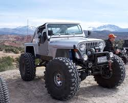 first jeep ever made jeep scrambler 1 ton axles coil overs and links small block