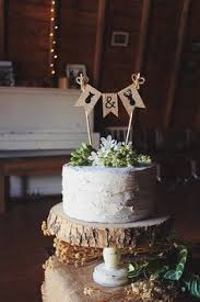 buck and doe cake topper the hunt is wedding cake topper wooden wedding deer cake