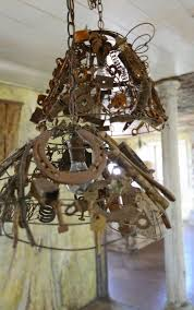 137 best hand made light fixtures images on pinterest lighting rustic light fixture made with rusty pieces such as keys bolts wire horseshoe