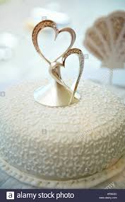 closeup of wedding cake with two hearts decoration beautiful