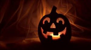 spooky halloween jack o lantern glowing on a bright orange