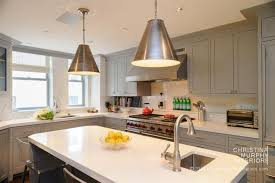 gray kitchen cabinets with white countertops contemporary