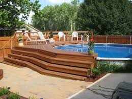 swiming pools pool deck with wooden tile also above ground liners