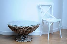 driftwood side table or coffee table glass topped modern design