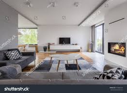 gray white family living room fireplace stock photo 674860528
