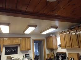 replace ugly fluorescent ceiling fixtures in kitchen