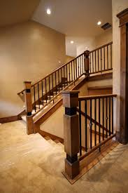 Iron Banisters Wood Railing With Wrought Iron Balusters Traditional Staircase