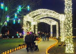christmas lights wichita ks people walk under the lighted arches for illuminations at botanica