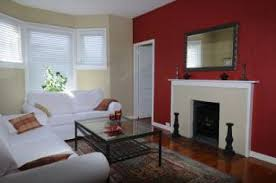 Red Bedroom Accent Wall - a cheerful living room featuring a bright red accent wall