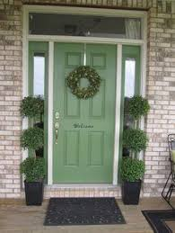 green front porch light pretty green front door i like the size of the greeting but i