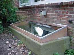 window well covers for masonry and wood window wells